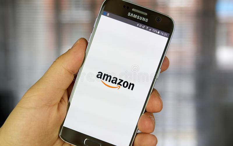 Amazon mobile application. MONTREAL, CANADA - MARCH 20, 2017 - Amazon mobile application on screen of Samsung S5 in hand. Amazon is an American electronic stock photography