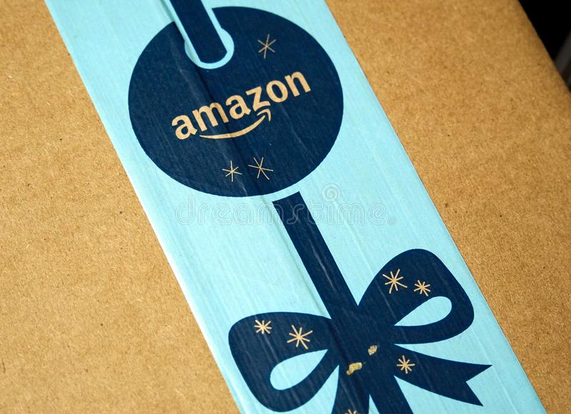 Amazon Prime holiday parcel logo. MONTREAL, CANADA - JANUARY 1, 2019: Amazon Prime holiday package with logo. Amazon, is an american technology company focusing stock photography