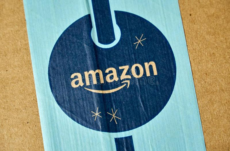 Amazon Prime holiday parcel logo. MONTREAL, CANADA - JANUARY 1, 2019: Amazon Prime holiday package with logo. Amazon, is an american technology company focusing stock images
