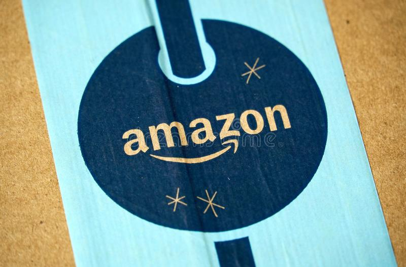 Amazon Prime holiday parcel logo. MONTREAL, CANADA - JANUARY 1, 2019: Amazon Prime holiday package with logo. Amazon, is an american technology company focusing royalty free stock photo