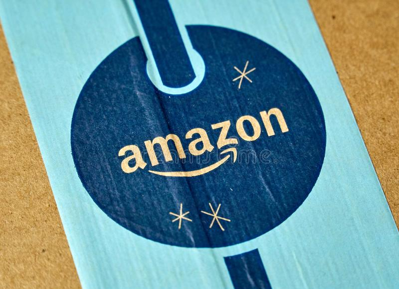 Amazon Prime holiday parcel logo. MONTREAL, CANADA - JANUARY 1, 2019: Amazon Prime holiday package with logo. Amazon, is an american technology company focusing royalty free stock images