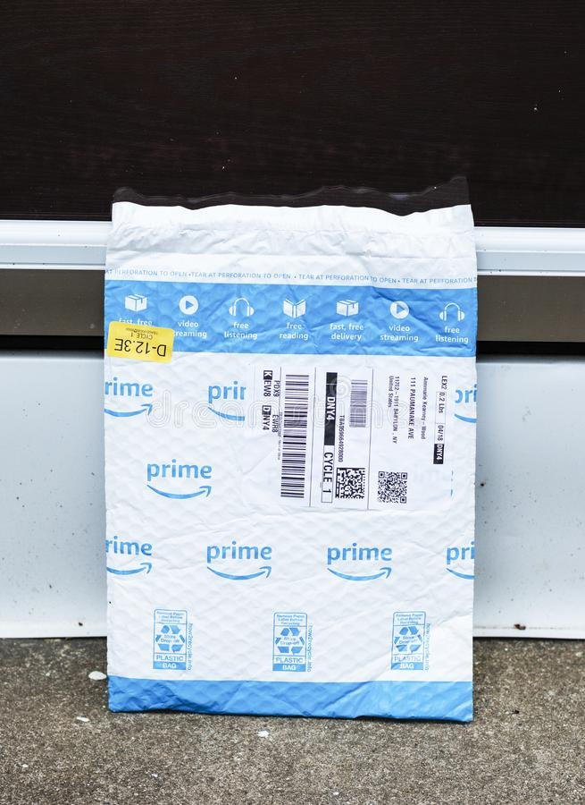 Amazon prime package left exposed at front door stock image