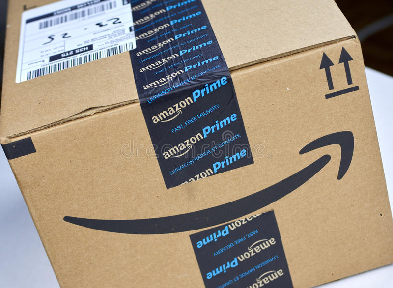 Amazon Prime shipping box. MONTREAL, CANADA - MARCH 28, 2017: Amazon Prime shipping box with branded tape on it. Amazon is an American electronic commerce and stock photos
