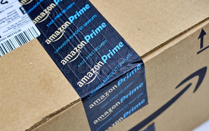 Amazon Prime shipping box. MONTREAL, CANADA - MARCH 28, 2017: Amazon Prime shipping box with branded tape on it. Amazon is an American electronic commerce and royalty free stock photos