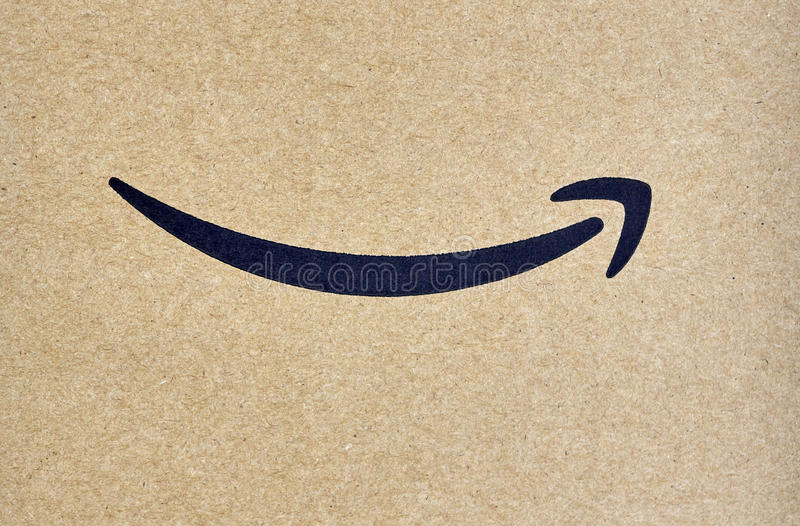 Amazon Prime shipping box. MONTREAL, CANADA - MARCH 28, 2017: Amazon Prime shipping box with branded tape on it. Amazon is an American electronic commerce and royalty free stock photo