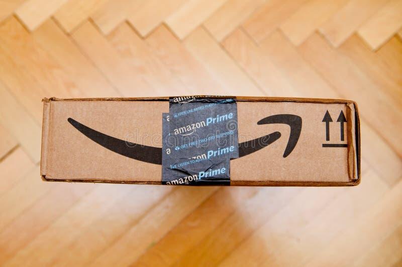 Amazon Prime smile arrow on a parcel cardboard box royalty free stock photos