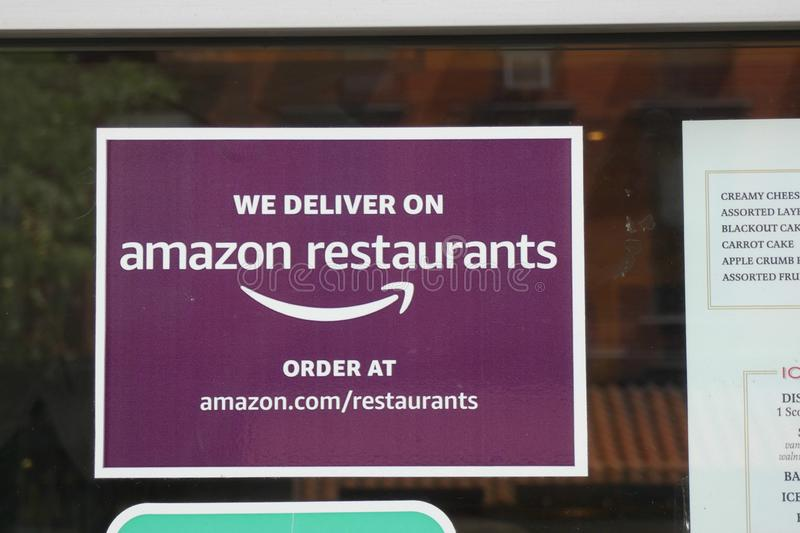 Amazon Restaurants. An Amazon Restaurants sign at a diner in New York City. Amazon Restaurants is an online food ordering service that belongs to online giant royalty free stock photo