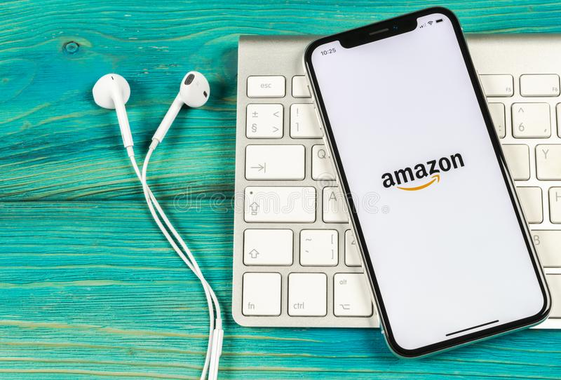 Amazon shopping application icon on Apple iPhone X screen close-up. Amazon shopping app icon. Amazon mobile application. Social m. Sankt-Petersburg, Russia, June royalty free stock photo