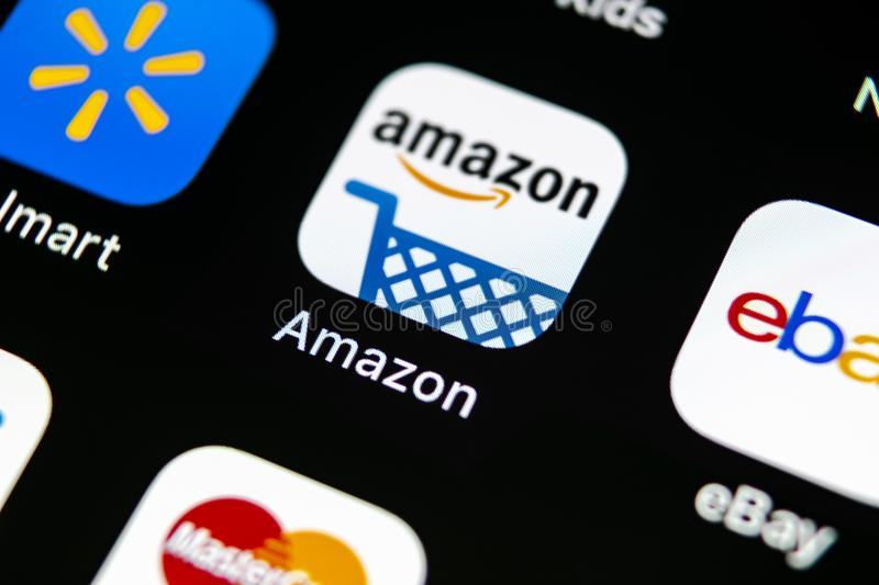 Amazon shopping application icon on Apple iPhone X screen close-up. Amazon shopping app icon. Amazon mobile application. Social me. Sankt-Petersburg, Russia, May royalty free stock photography