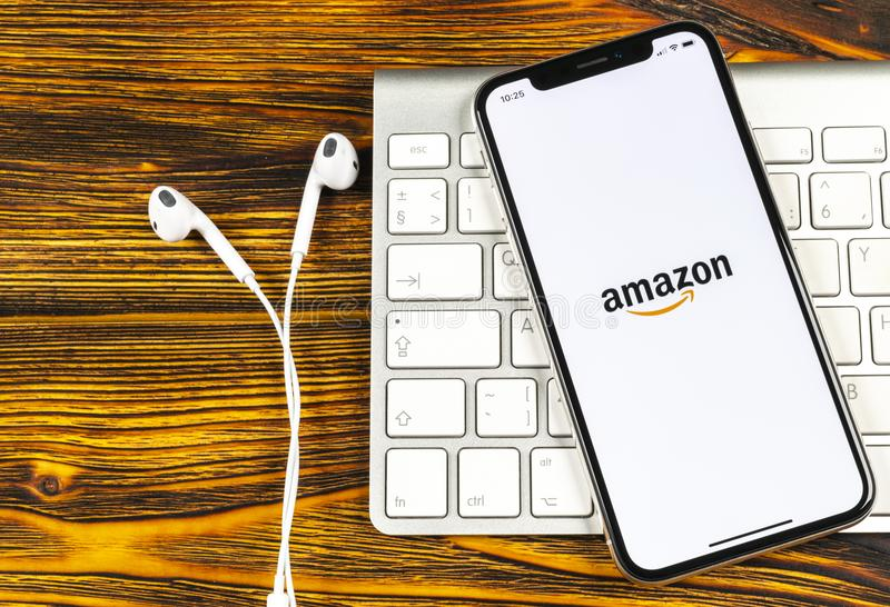 Amazon shopping application icon on Apple iPhone X screen close-up. Amazon shopping app icon. Amazon mobile application. Social me. Sankt-Petersburg, Russia royalty free stock photos