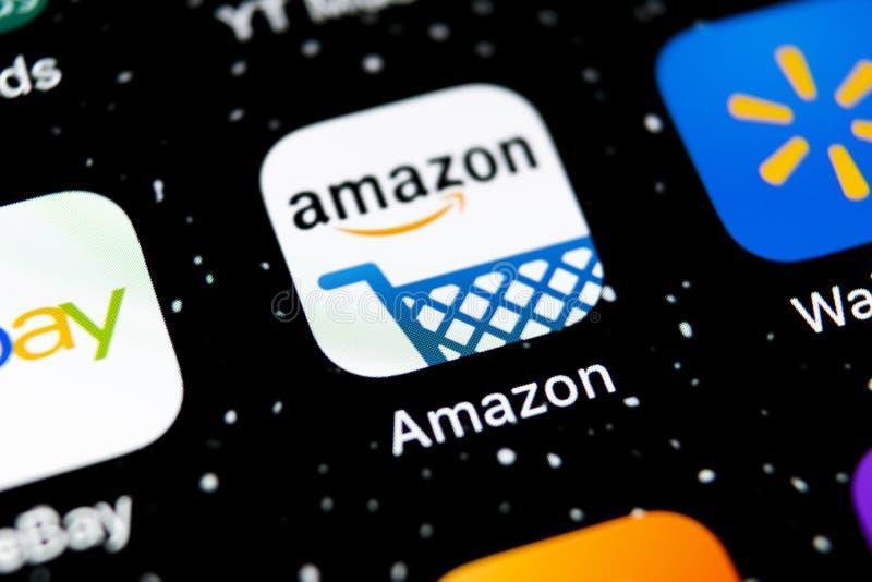Amazon shopping application icon on Apple iPhone X screen close-up. Amazon shopping app icon. Amazon mobile application. Social me. Sankt-Petersburg, Russia stock photos