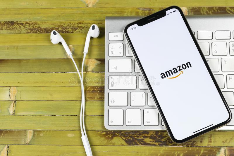 Amazon shopping application icon on Apple iPhone X screen close-up. Amazon shopping app icon. Amazon mobile application. Social me. Sankt-Petersburg, Russia royalty free stock image