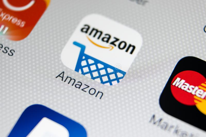 Amazon shopping application icon on Apple iPhone X screen close-up. Amazon shopping app icon. Amazon mobile application. Social. Sankt-Petersburg, Russia royalty free stock photo