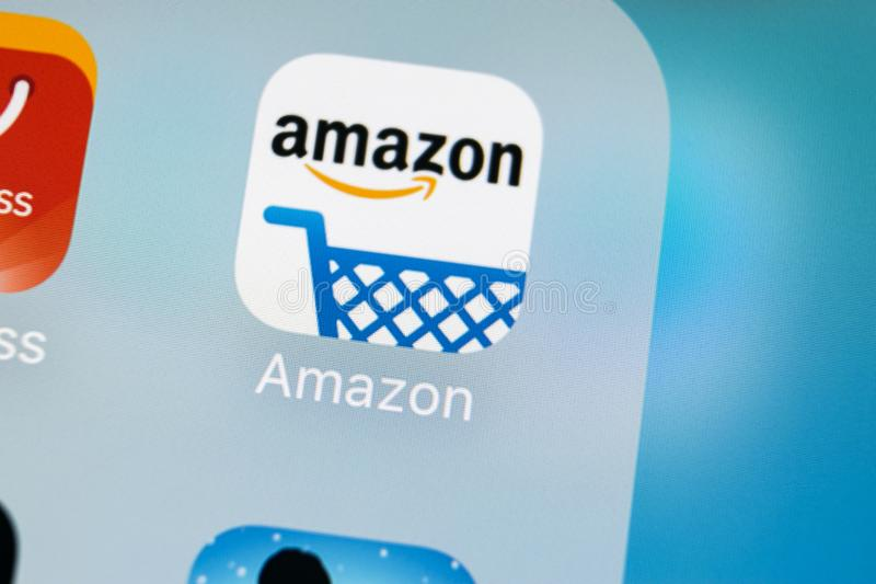 Amazon shopping application icon on Apple iPhone X screen close-up. Amazon shopping app icon. Amazon mobile application. Social. Sankt-Petersburg, Russia, March royalty free stock photo