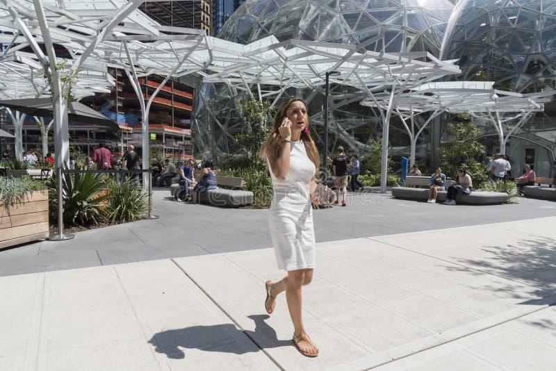 Amazon World Headquarters woman on phone royalty free stock photos