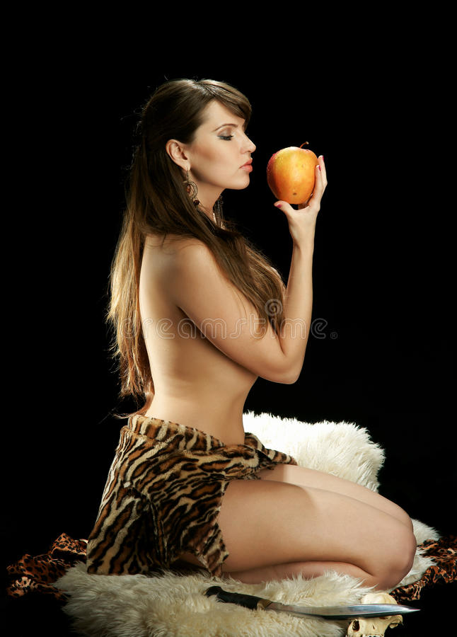 Amazonas mit einem Apfel stockfotos