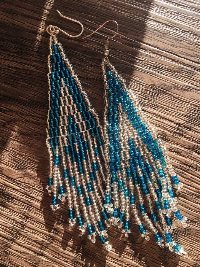 Shimmery Handmade Amazon Beaded Earrings stock image