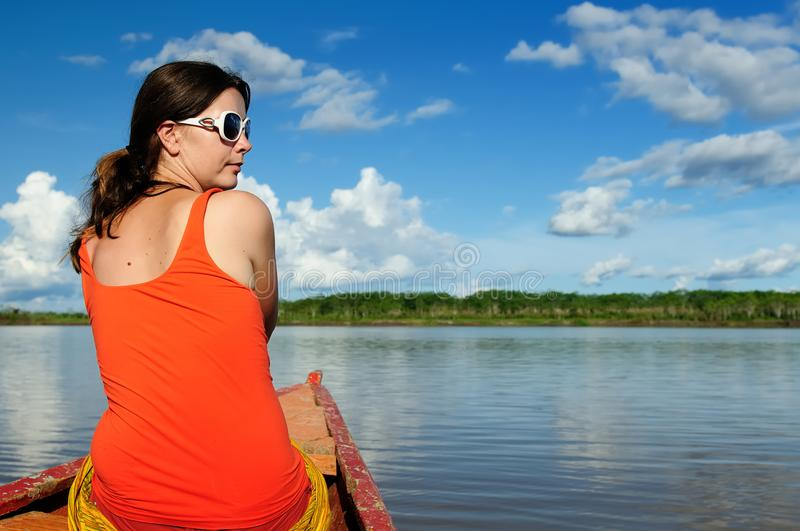 The Amazonian jungle explore by boat by the tourist stock photography