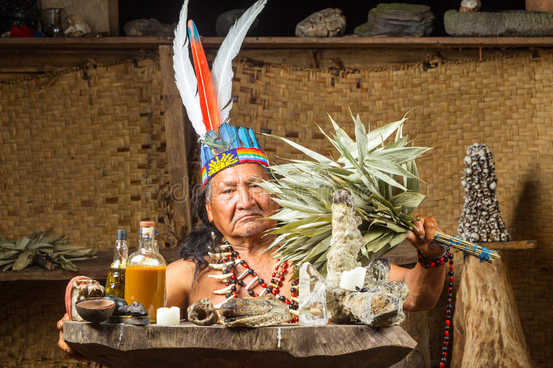 Amazonian Shaman Portrait. Shaman In Ecuadorian Amazonia During A Real Ayahuasca Ceremony Model Released Image As Seen In April 2015 royalty free stock photo