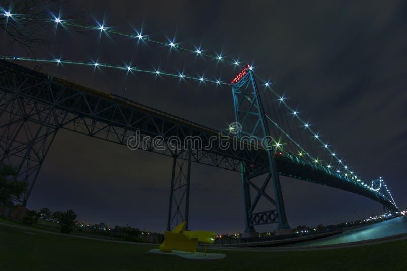 Ambassador Bridge. Connecting Windsor, Ontario to Detroit Michigan at night, taken with a fisheye lens stock photo