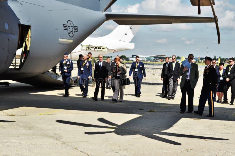 Ambassador. Romania's US ambassador Hans Klemm with the US Air Force walking and inspecting a C 130 Hercules aircraft stock image
