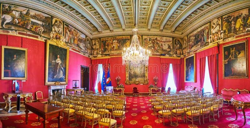 Ambassador`s Room in Grandmaster`s Paalce of Valletta, Malta. VALLETTA, MALTA - JUNE 17, 2018: Panorama of Ambassador`s Room of Grandmaster`s Palace in red gamma stock image