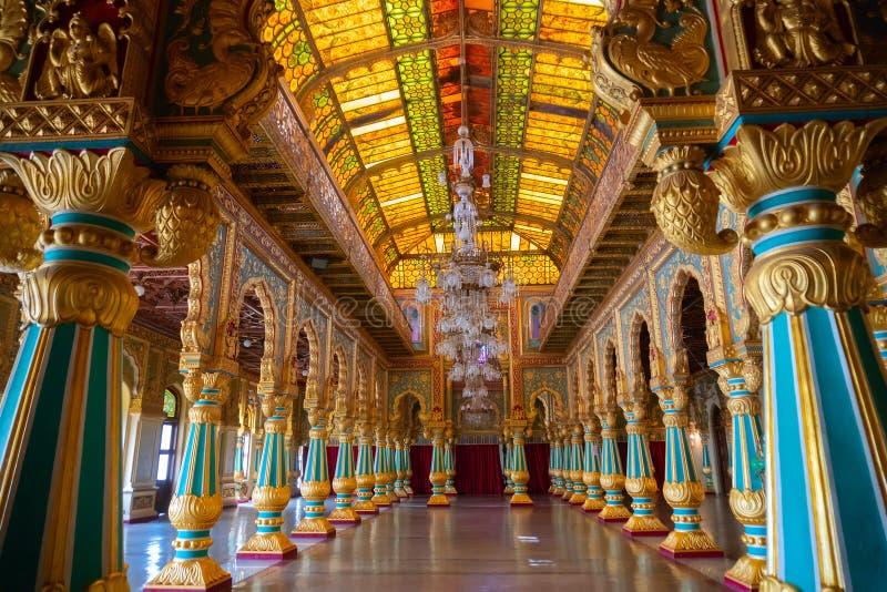 Ambavilasa Hall, Mysore Palace, Karnataka, India. Mysore, Karnataka, India - November 25th 2018 : Beautiful decoated interior ceiling and pillars of the stock photos