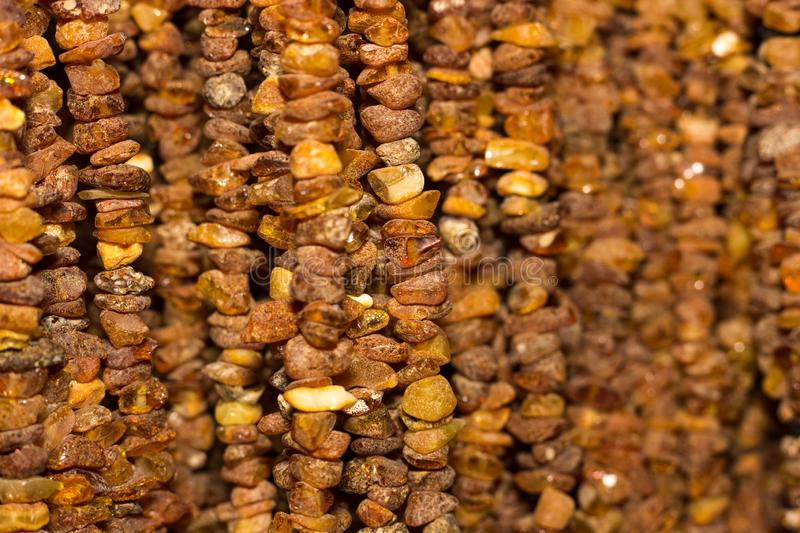 Amber background. Texture of amber beads. A lot of amber pieces strung on a thread.  stock photography
