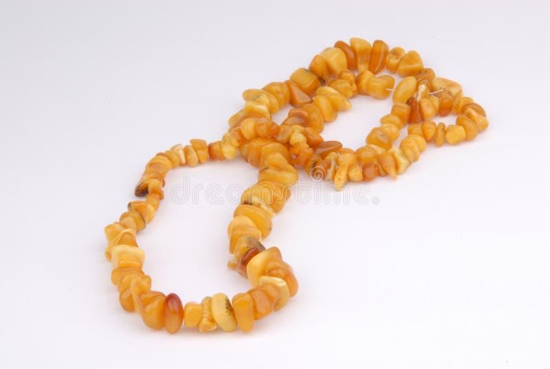 amber beads halsbandwhite arkivfoton