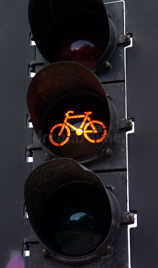 Amber bicycle light. Traffic light for bicycles with amber light on royalty free stock photography