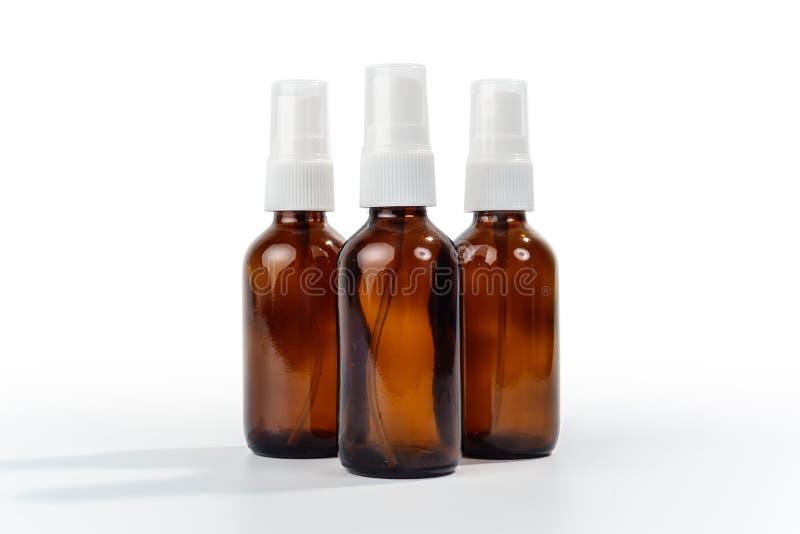 Amber Brown Glass Spray Bottles foto de stock