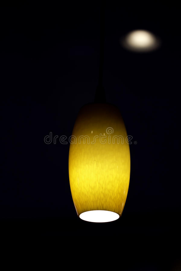 Amber Colored Hanging Ceiling Light Stock Photos
