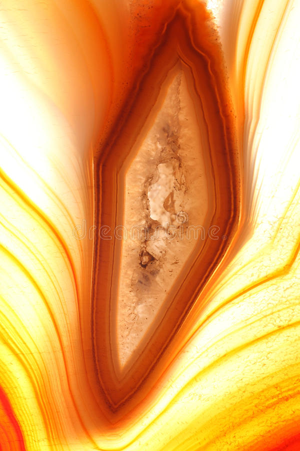 Amber coloured agate. Details of the inside and center of an amber coloured agate stock image