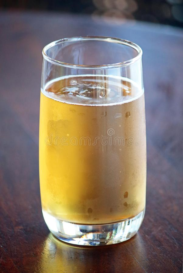AMBER COLOURED COLD BEER IN A GLASS stock image