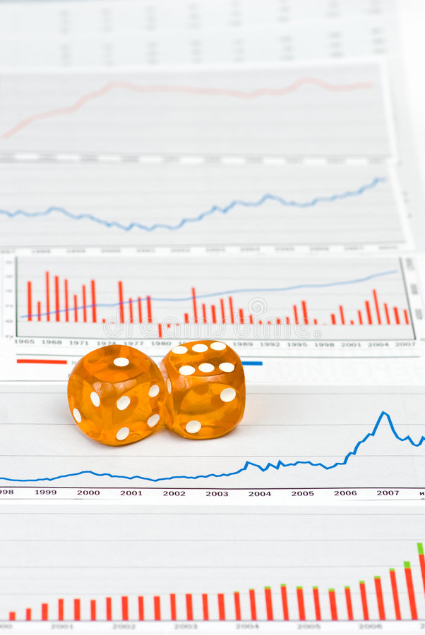 Amber dice on figures royalty free stock photos