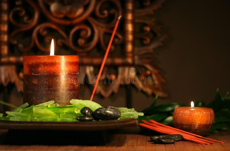 Amber gekleurde kaarsen royalty-vrije stock foto's