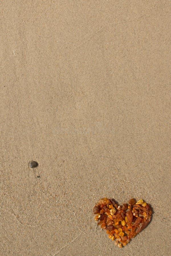 Amber heart royalty free stock photo
