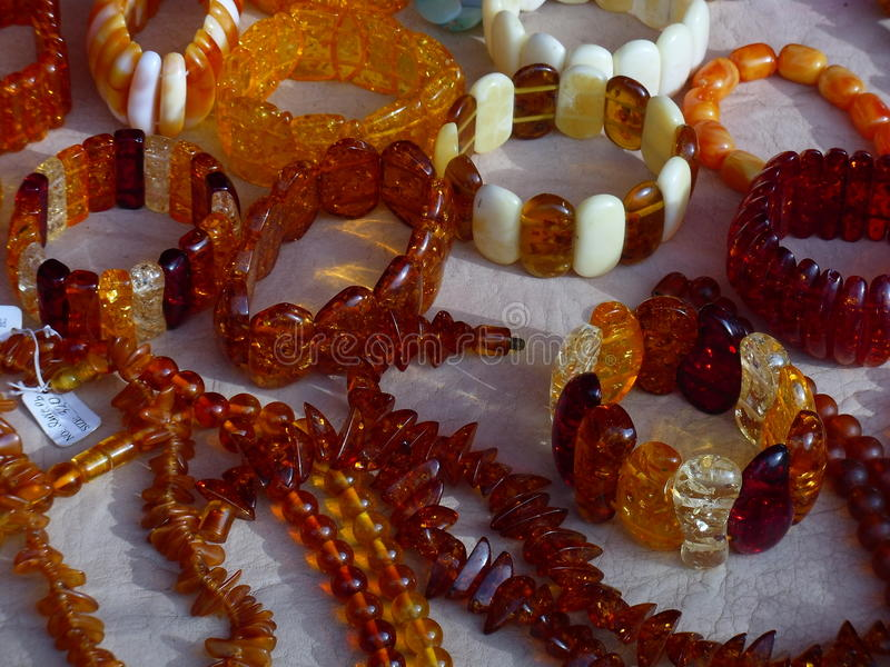 Amber jewelry. Modern fashion trends have contributed to a new surge in the popularity of amber goods. Our ancestors believed that amber helps to cure various stock photos