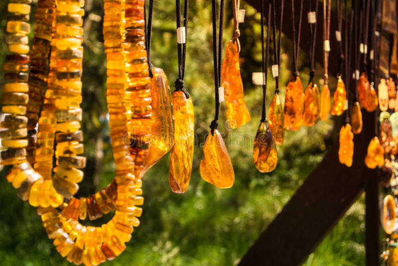 Amber pendants and necklaces at the street market of Curonian Spit, Kaliningrad region. Russia royalty free stock photo