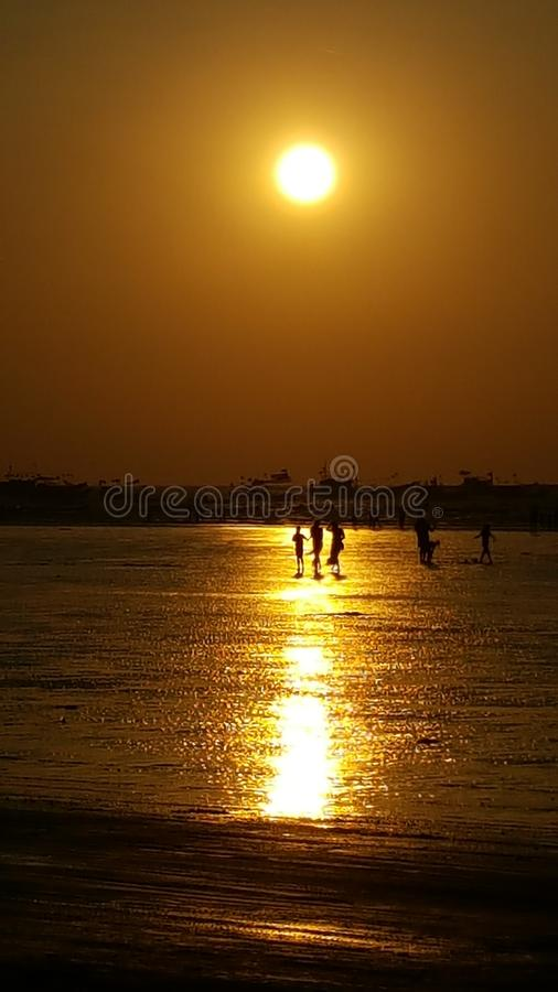 Amber sunset at sea stock photography