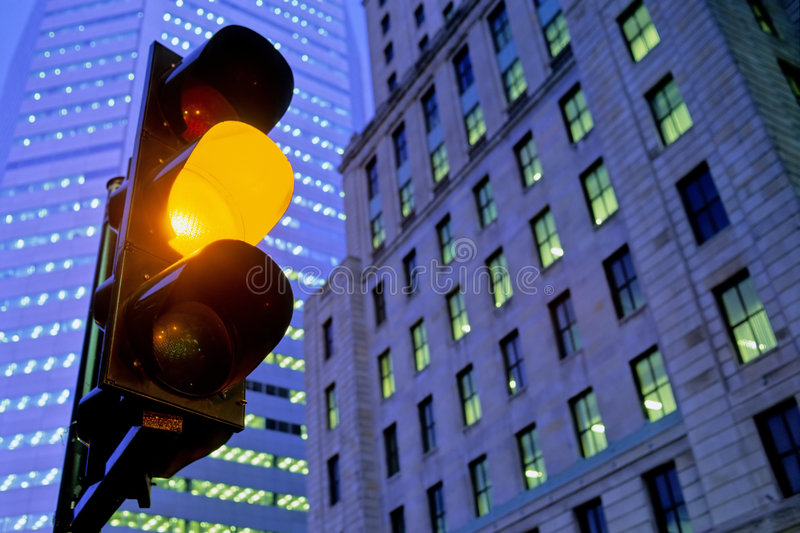 Amber traffic light in city stock photos