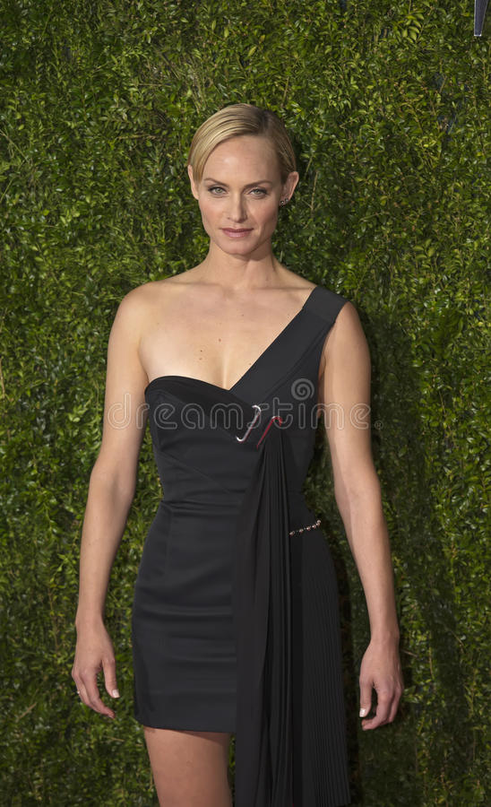 Amber Valletta Arrives at the 2015 Tony Awards. Model Amber Valletta wearing a black one-shoulder gown by Anthony Vaccarello arrives on the red carpet for the stock photo