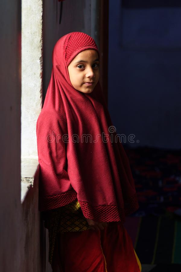 Indian muslum young girl standing at window in Amer. Rajasthan. India royalty free stock images