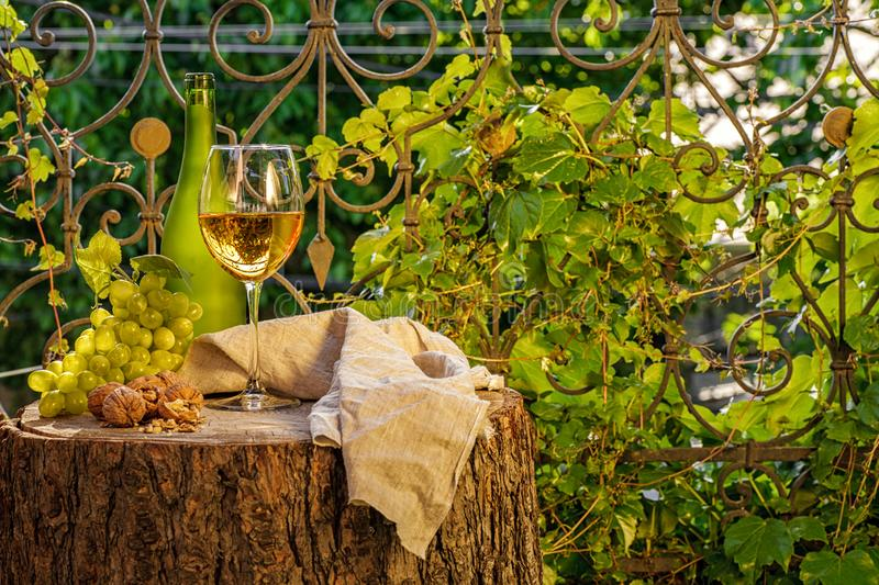 Amber wine in the glass stock photography