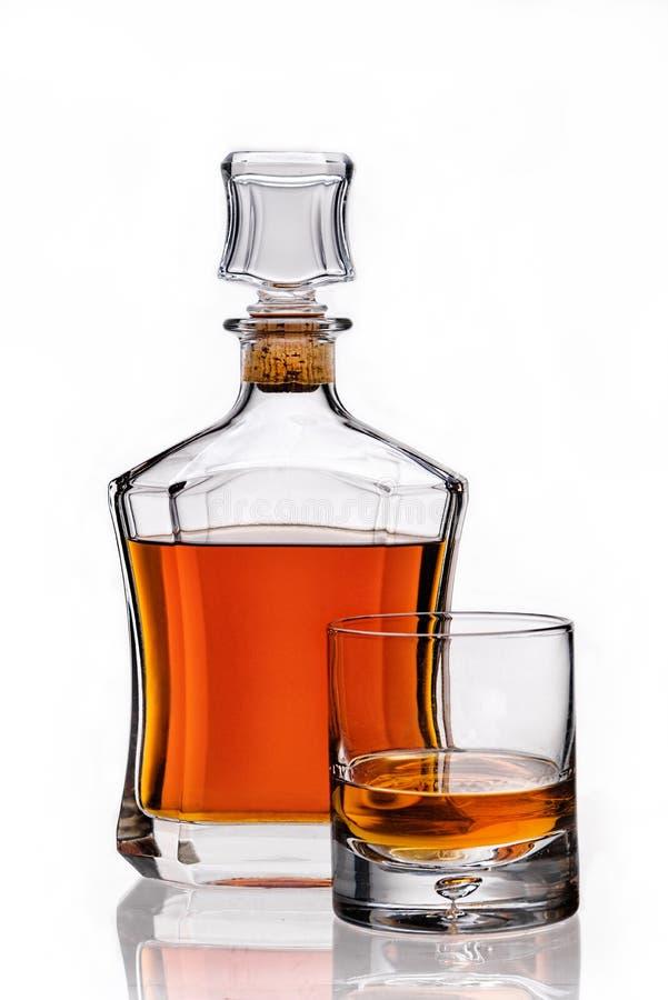 Amberwhisky en glas royalty-vrije stock afbeelding