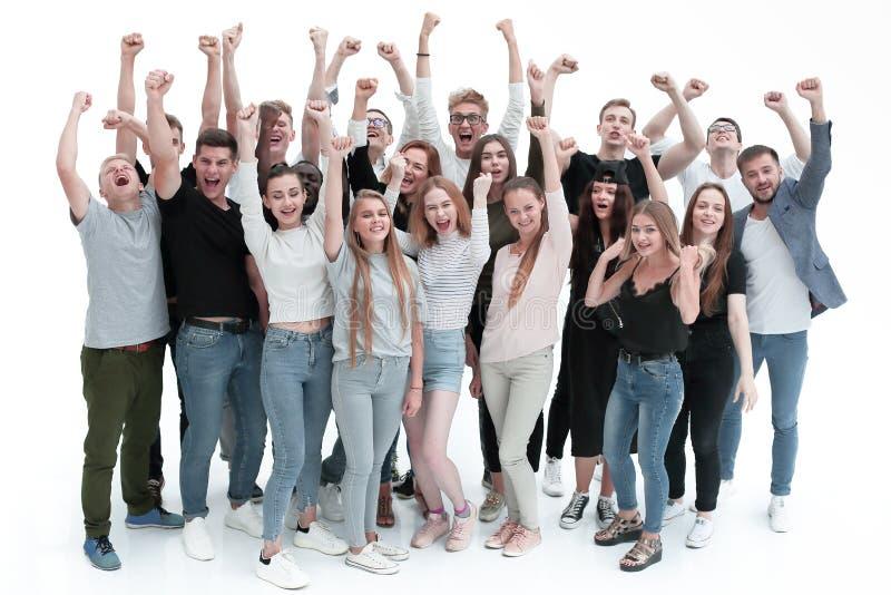 Ambicioso equipo de jóvenes con las manos arriba imagen de archivo libre de regalías