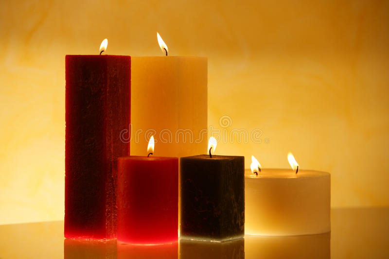 Ambient candles. Group of brown , yellow and red candles creating spa atmosphere royalty free stock photo