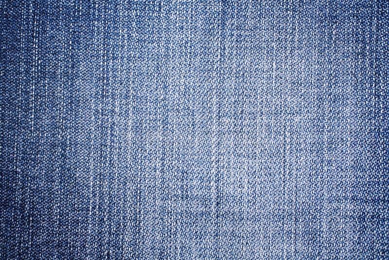 Ambiti di provenienza strutturati dei jeans fotografia stock libera da diritti