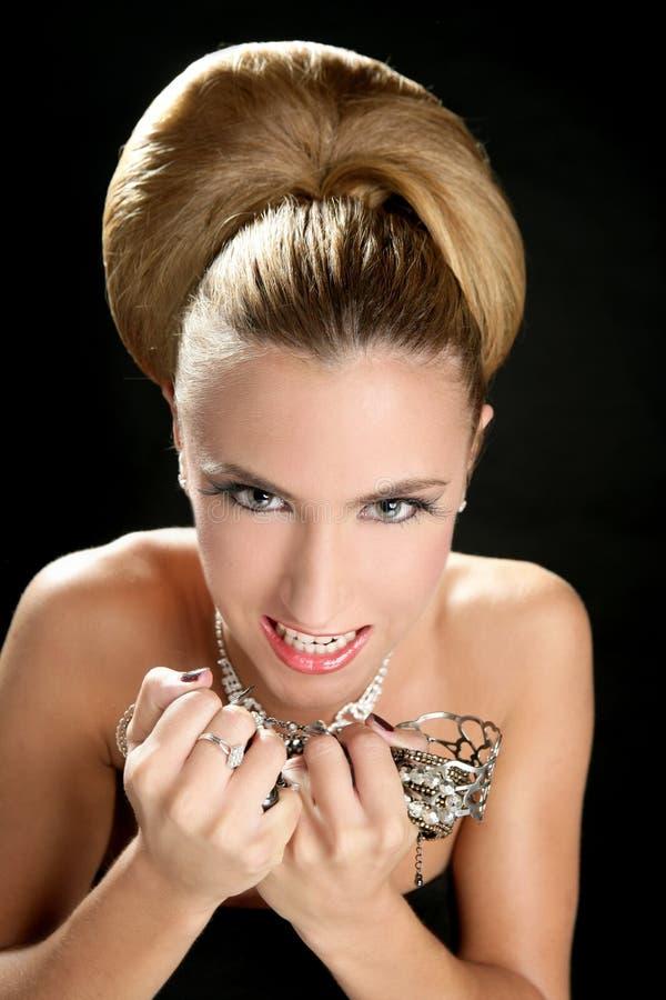 Ambitie en hebzucht in maniervrouw met juwelen royalty-vrije stock fotografie