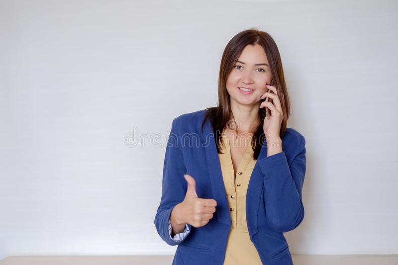 Ambitious businesswoman talking by phone at modern office workplace royalty free stock images
